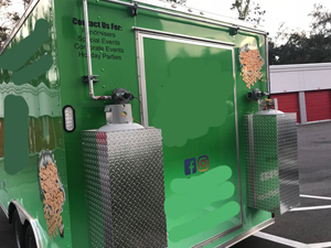 Back of Green Donut Trailer for Sale
