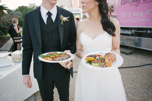 Bride and Groom with Food from Food Trucks