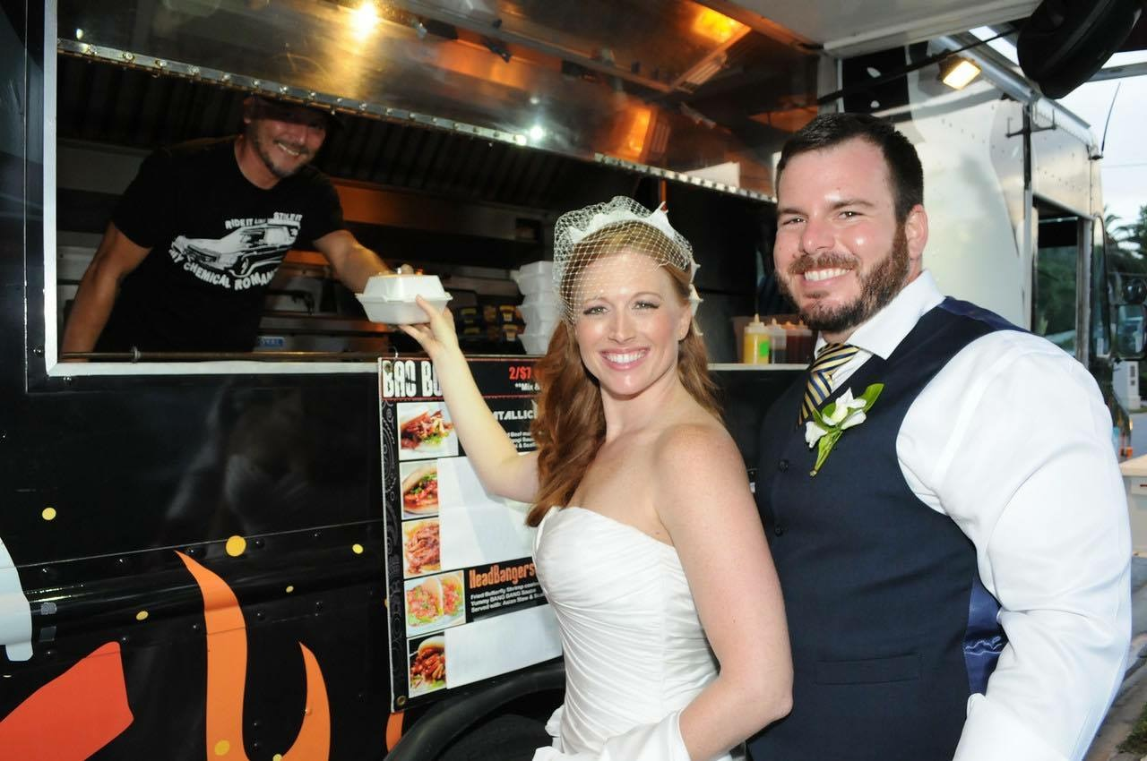 Couple by Food Truck at Wedding Service